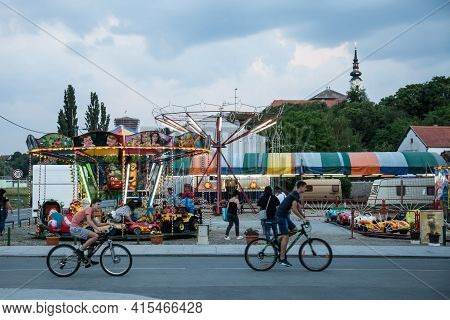 Belgrade, Serbia - May 12, 2018: Children Roundabout, A Merry Go Round With Cars Spinning While Blur