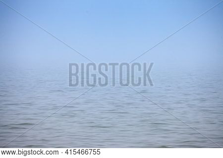 Smoggy Blurry Mysterious Fog In Winter In Front Of Blue Waters Of Palic Lake, In Subotica, Serbia. A