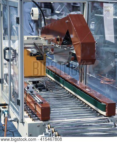 Carton On Roller Conveyor Packing On Automatic Carton Tape Sealing Machine. Industrial Logistics War