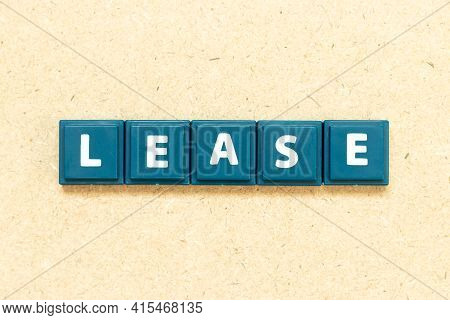 Tile Alphabet Letter In Word Lease On Wood Background