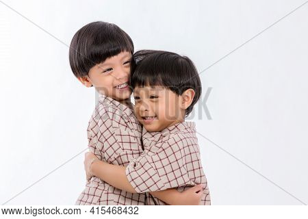 Twin Boys Hugging  On White Background. Portrait Of Little Son Hugging Brother Or Friend. I Missing