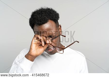 Sleepy African American Man Take Off Glasses Rubbing His Eyes Feels Tired After Work On Laptop Compu