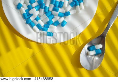 Tablets On A Plate. Medicine For The Patient On A Spoon. Tablet On A Spoon. Pharmacy Products From T