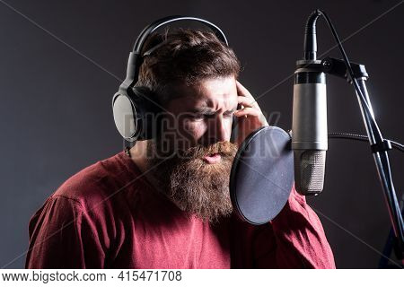 Man With Microphone Singing Song. Musician In Music Hall. Guy Meloman Singing In Karaoke