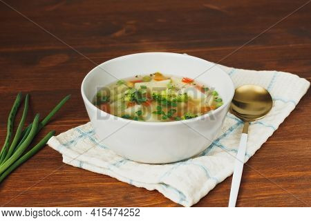 Spring Soup With Colorfull Vegetables. Vegan Or Lenten Soup With Carrot, Potatoes, Broccoli, Peas, C