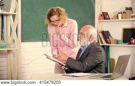 School Project. Student Girl With Tutor Man At Blackboard. Pass Exam. Teachers Room. Getting Informa