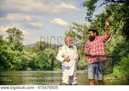 Catching And Fishing Concept. Fly Fish Hobby Of Businessman. Retirement Fishery. Retired Dad And Mat