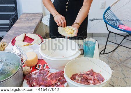 Person Preparing Quesadillas. Preparation Of Typical Mexican Food.