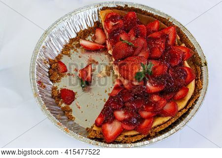 Delicious Cheesecake Decorated With Strawberries. Isolated Cheesecake.