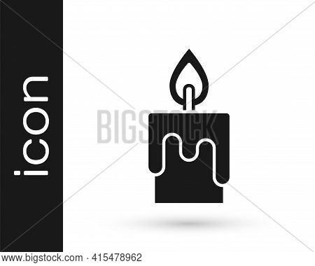 Black Burning Candle Icon Isolated On White Background. Cylindrical Candle Stick With Burning Flame.