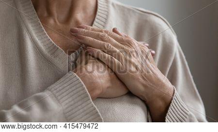 Mature Elderly Woman Feeling Heart Pain, Touching Chest