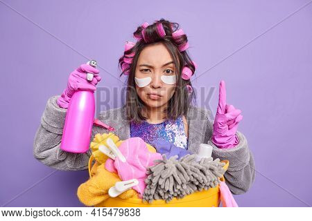Attentive Housewife Applies Hair Rollers For Making Hairstyle Wears Beauty Patches Under Eyes Dresse