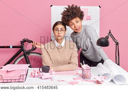 Two Diverse Women Business Developers Take Minute Break During Work Make Funny Grimace At Camera Cre