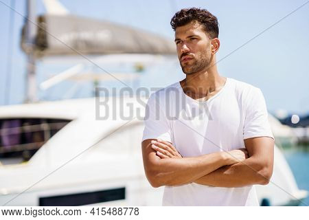Fitness Model In Sportswear Outfit Posing On Waterfront Harbour.