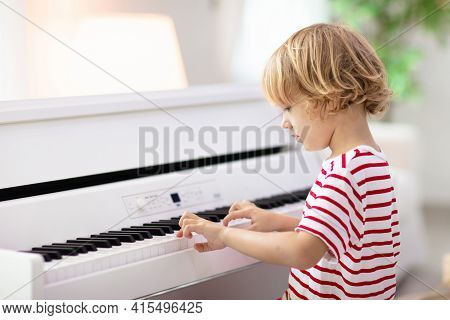 Child Playing Piano. Kids Play Music. Classical Education For Children. Art Lesson. Little Girl At W
