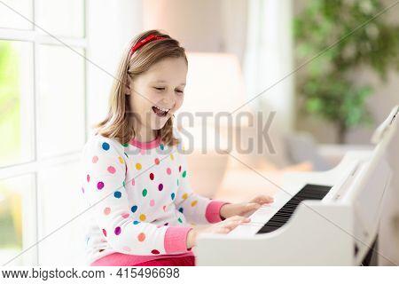Child Playing Piano. Kids Play Music.