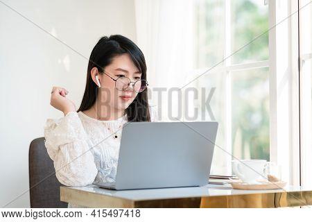 Happy Of Asian Freelance People Businesswoman Wearing Wireless Earphones Casual Working With Laptop