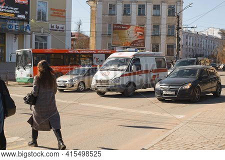 Cars At The Crossroads In The City. Ambulance Car Standing At The Traffic Light. Smolensk, Russia 04