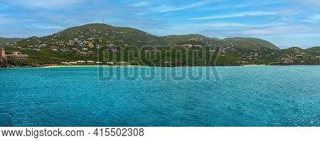 A Panoramic View Of St Thomas With The Turquoise Colored Water.