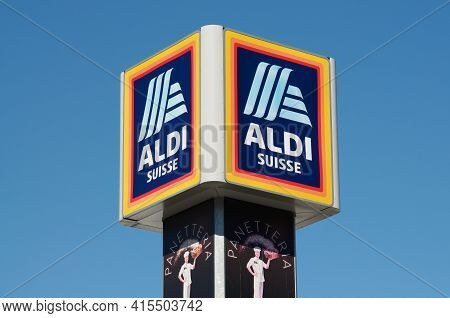 Giubiasco, Switzerland - 20th March 2021 : Aldi Suisse Sign Hanging On The Top Of A Store In Giubias