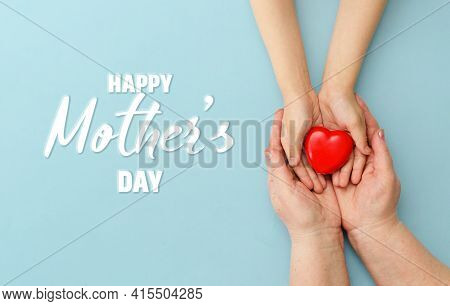 Concept Happy Mother's Day Or International Day Of Families.happy Women's Day.heart In The Hands Of