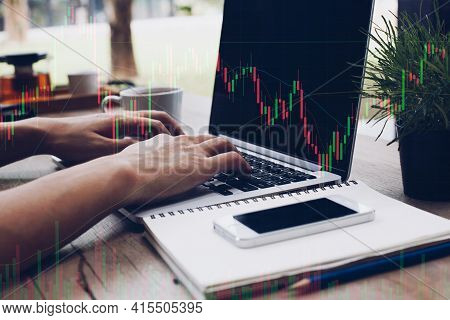 Trader Holding In Hands Researching Stock Market To Proceed Right Investment Solutions.