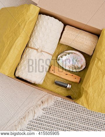 Gift Box With Natural Household Items - Luffa, Muslin Towel, Shell And A Small Block Of Palo Santo W