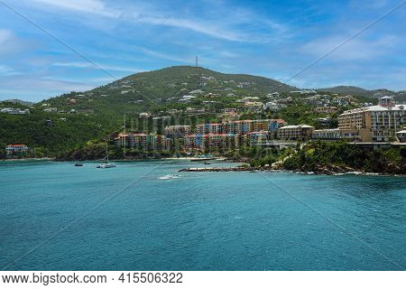 A Scenic View Of St Thomas With Hotels, Condos And Turquoise Colored Waters.