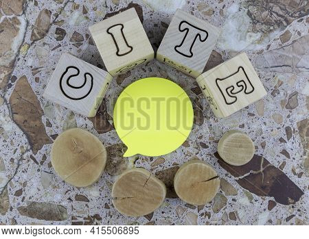Cite - Concept With Alphabet Letters And Cross Section Wooden Circles Arranged As A Border Around A