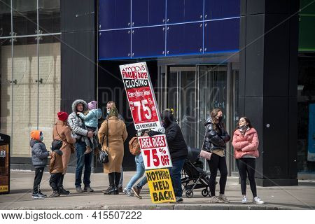 Chicago, Il March 14, 2021, Person Standing At A Street Corner On Michigan Avenue Promoting Macys St