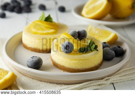 Cheesecake Lemon Tart Cake Or Pie, With Fresh Lemon,blueberry And Mint. White Background, Lifestyle
