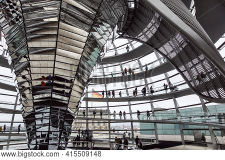 Berlin, Germany - December 27, 2020 : People Visit Reichstag Building Dome In Berlin. The Dome Was C