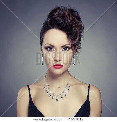 Fashion photo of beautiful lady with evening make up