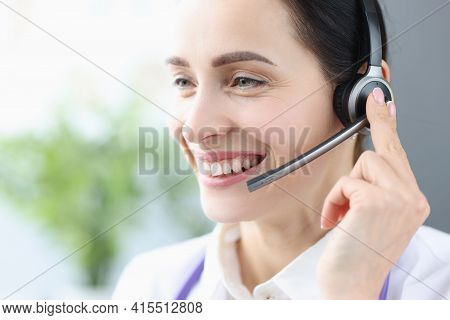 Portrait Of Smiling Woman With Headphones And Microphone