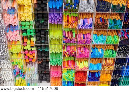 Colored Pens, Pencils And Markers On Shelves In Shop. Office Supplies And Stationery. Colorful Pens
