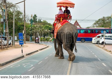 Tourist Riders On Elephant On City Road In Ayutthaya, Thailand