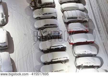 Cars On Night Winter Parking Lots