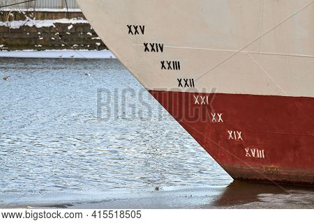 Old Ship Draft On Hull, Scale Numbering. Distance Between Waterline And Bottom Keel. Ship In Water.
