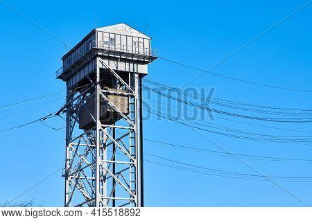 Tower Of Two-tier Vertical Lift Bridge. Bunk Bridge In Kaliningrad City. Blue Sky Background