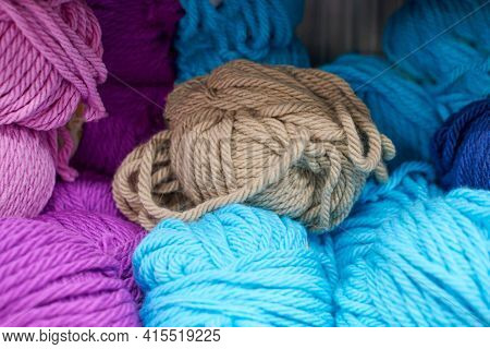 Multicolored Yarn Balls In Knitting Shop Center, Close Up. A Lot Of Color Yarn For Knitting. Colorfu