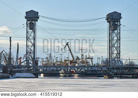 Two-tier Vertical Lift Bridge With Railways Car Road. Industrial Cityscape. Bunk Bridge In Kaliningr