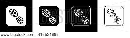 Set Human Footprints Shoes Icon Isolated On Black And White Background. Shoes Sole. Vector