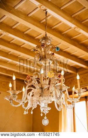 Beautiful Murano Glass Crystal Chandelier, Under A Wooden Ceiling.