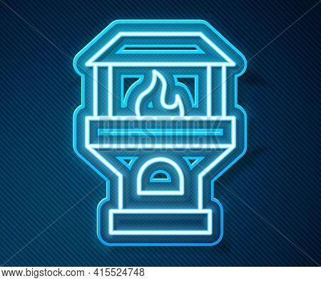Glowing Neon Line Brick Stove Icon Isolated On Blue Background. Brick Fireplace, Masonry Stove, Ston