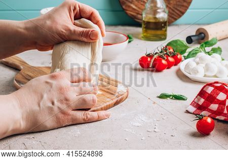 Female Hands Make Pizza. The Ingredients For Homemade Margherita Pizza On Stone Background.