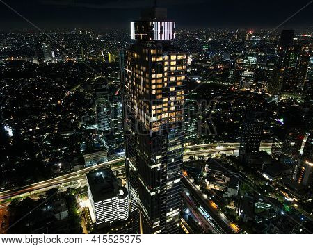 Spectacular Nighttime Skyline Of A Big Modern City At Night. Jakarta, Indonesia. Aerial View On High