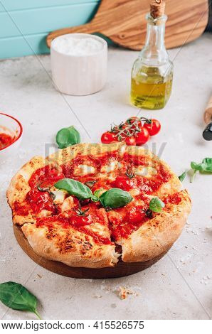 Homemade Pizza With Tomatoes, Basil And Mozzarella Cheese.