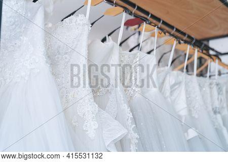 Close Up White Wedding Dresses In Dress Store, Bride Dress