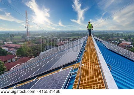 Solar Energy, Engineering Working On Roof Checking And Maintenance In Solar Power Plant , Solar Powe