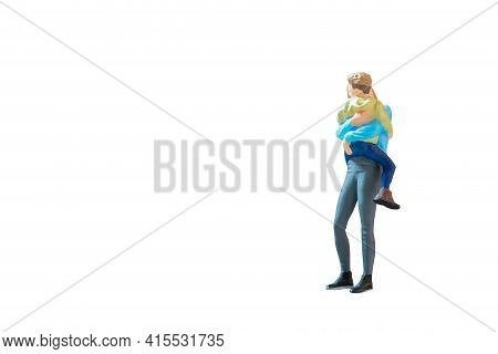 Miniature People Mother Holding Her Cute Baby Son In The Arms On White Background With Clipping Path